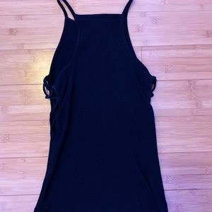 Black spaghetti strap top with side cut outs.